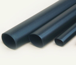 Heat shrinkable tubes with adhesive